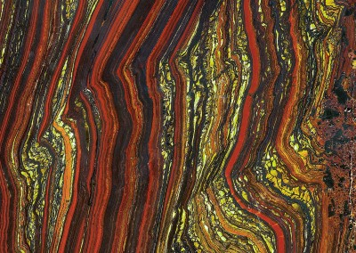 Rain Forest (ST0451)-Detail : Exotic wall covering pattern of burnt sienna and green/yellow polished rock with the feel of stained glass or a detail from a Klimpt painting. © 2015 Doug Garrabrants