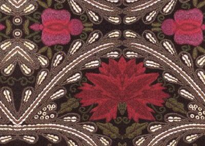 "Chalet (DE3335)-Detail : Red and fushia flowers on a dark background with beaded trim. 19"" x 32"" repeat. © 2013 Doug Garrabrants"