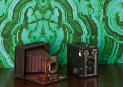 "Malachite Verde (100%) : Wallpaper Pattern created from the a hand painted malachite by Lena Fransioli. Shown here with a Kodak, ""Brownie Target Six-16"" and  a Rochester Optical Co., ""Pony Premo D"" camera. © 2013 Doug Garrabrants"