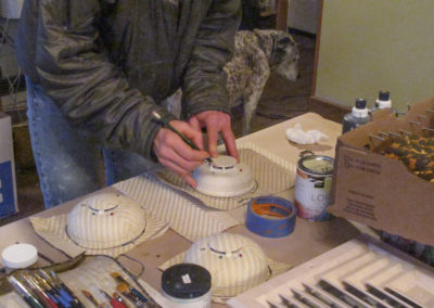 Lena painting smoke detector to look like chevron grasscloth for Wellen Construction and Kemble Interiors.